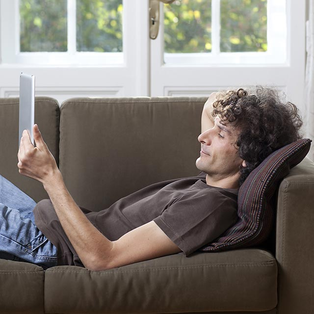 reading-tablet-on-couch177097351.jpg